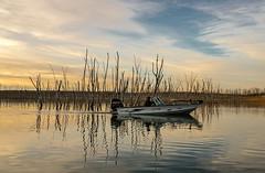 November boating (nwitthuhn) Tags: water boat trees november sky kansas sunset