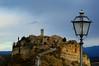 A Lamp on civita (moniq84) Tags: civita lazio bagnoregio viterbo italy landscape lamp church houses roofs cloudy nikon