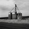Silos, Eastern Washington (austin granger) Tags: silos washington palouse farming field roadside crop farm winter grass structure square film gf670
