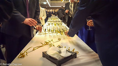 Celebriting New Years Eve (kaprysnamorela) Tags: philharmonia kielce poland music champaigne table glass glasses people perspective afternoon building reflection samsung wine