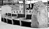 between a rock and a hard place... (Harry Halibut) Tags: 2017©andrewpettigrew allrightsreserved contrastbysoftwarelaziness noiretblanc blackwhite blancoynegro blanc weiss noire schwatz bw zwart wit bianco nero branco preto blackandwhite imagesofsheffield images sheffieldarchitecture sheffieldbuildings sheffield south yorkshire sheff1712185192 charter square row seating rock concrete wood slats thelight light cinema complex