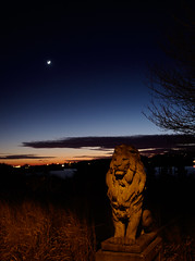 Stone Lion in Winter (Paul Henegan) Tags: fortpond montaukny moon yule availablelight bluehour branches clouds crepuscule dusk earthshine grasses handheld silhouette stonelion tree waxingcrescent winter fb