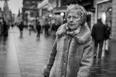Another Year Older, Another Year Wiser (Leanne Boulton) Tags: portrait people urban street candid portraiture streetphotography candidstreetphotography candidportrait streetportrait eyecontact candideyecontact old elderly woman female streetlife face expression eyes look emotion mood winter fur style stylish fashion tone texture detail depthoffield bokeh naturallight outdoor light shade city scene human life living humanity society culture canon canon5d 5dmkiii 70mm ef2470mmf28liiusm black white blackwhite bw mono blackandwhite monochrome glasgow scotland uk