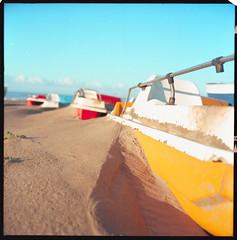 (We All Float) (Robbie McIntosh) Tags: rolleiflex rolleiflex28e rolleiflex28e2 rolleiflexplanar28e carlzeissplanar80mmf28 tlr 120 mediumformat 6x6 square negative film filmisnotdead moyenformat mittelformat medioformato pellicola selfdevelopment dyi homedevelopment kodak kodakektar100 ektar newtopographics newtopography c41 color bellinifoto bellinic41 bellini decay landscape beach mondragone dunes pedalo boat