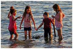 Kids at the Beach in Play (HereInVancouver) Tags: children water ocean pacific playing wetclothes floating englishbay vancouverswestend vancouver bc canada canong3x candid streetphotography