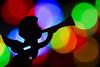 Blowing bokeh bubbles -[ HMM ]- (Carbon Arc) Tags: macromondays memberschoicebokeh angel cherub chime horn bokeh bubbles christmas lights holiday electric led backlight silhouette