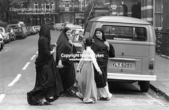 MUSLIM ARAB WOMEN WEAR BURQUA LONDON 1970s BRITAIN (Homer Sykes) Tags: arabs middleeastern london poor healthcare tourism healthcaretourists archivestock muslim woman women female uk british society england english britain archive archival 1970 1970s people person hijab burka islamic dress headscarf covered head myref13a3085 1977 70s gbr