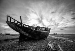 Run aground (grbush) Tags: derelict decay rotting abandoned bw blackwhite monochrome beach coast coastline shore shingle dungeness kent boat clouds sky dramatic sonya7 tokinaatx116prodxaf1116mmf28