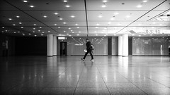 Dark <-> Light (grizzleur) Tags: dark darkness light bright walk walking step stride man guy dude scene stage reflections large vast space freezeframe eyecontact street streetphotography fuji fujilove fujixt20 fujifilm düsseldorf congress center messe