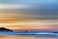 Dawn Breaks (Gary Grossman) Tags: dawn morning early winter garygrossmanphotography shore coast ocean pacific waves sand clouds reflections nature pacificnorthwest pacificocean cannonbeach water oregon