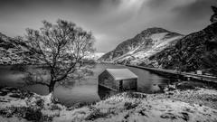 Winter ...has arrived ! (Einir Wyn Leigh) Tags: landscape snow winter mountain boathouse tree drama december christmas lake water wales cymru uk blackandwhite mono