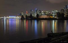 Vancouver At Christmas (Clayton Perry Photoworks) Tags: vancouver bc canada night lights christmas explorebc explorecanada city skyline reflections stanleypark coalharbour deadmansisland hmcsdiscovery
