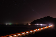 5 am Rush Hour (tquist24) Tags: nikon nikond5300 pch pacificcoasthighway pacificocean pointmugu geotagged lighttrails lights longexposure mountin night nightsky ocean reflection reflections road sky stars water malibu california unitedstates