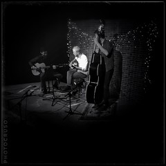 Swing Trio (PHOTOSORIANO) Tags: guitars uprightbass bass musicians instruments mediumformat bw bn darkr iphonese plate tv trio swing music