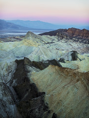 Zabriskie Dawn (lycheng99) Tags: zabriskiepoint zabriskie deathvalley deathvalleynationalpark nature nationalgeographic nationalpark manlybeacon peaks valleys rocks rockformation geology california landscape color sky pink