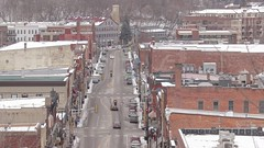 Downtown Stillwater Traffic Compressed (Sam Wagner Photography) Tags: stillwater minnesota motion movement winter small midwest town mn wisconsin wi border st croix river traffic compression telephoto rural car downtown