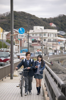 High school student couple going to school together