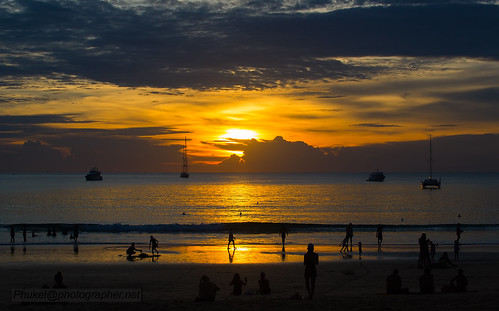 Sunset with yachts, Nai Harn beach, Phuket island, Thailand