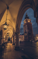 In Krakow old town (Vagelis Pikoulas) Tags: krakow old town square poland travel november autumn 2017 clock blue hour night lights canon 6d tokina 1628mm landscape city cityscape