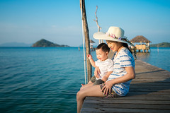 Asian mother and baby sit togather on the wooded bridge (I love landscape) Tags: baby mom beach mother family happy sea summer woman young motherhood kid people beautiful female girl caucasian white travel vacation ocean little child daughter parent sit thailand mak kood koh island phi phuket pattaya samui thai asia asian wood bridge outdoor love holiday childhood water cheerful mum together day lifestyle boy