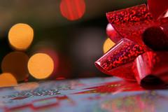 DSC03791RP (Scott Glenn) Tags: macromondays bokeh sony alpha slta65v sal70300g 4filter macro closeup ribbon bow christmas gift package wrap wrapped paper lights