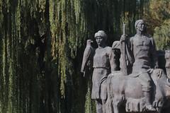 Bishkek Monument (peterkelly) Tags: kyrgyzstan victorymonument victorysquare bishkek statue sculpture eagle gun hat man tree digital asia canon 6d gadventures centralasiaadventurealmatytotashkent