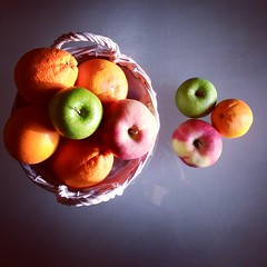 Symphony in orange, red & green (jimiliop) Tags: orange red green experiment colours fruits basket stilllife food goods light natural healthy reflection home oranges apples