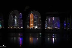 Doha Skyline (pbmultimedia5) Tags: skyline city night photography lights reflections urban corniche doha qatar arches architecture pbmultimedia waterfront