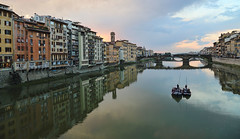 Boating in Florence (Jan Kranendonk) Tags: florence firenze italy italian europe buildings houses architecture rennaissance sunny landmark sky blue stone medieval bridge river arno water pontevecchio reflection evening mirror boat tour tourists boating excursion