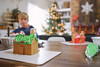 It's looking a lot like Christmas (Elizabeth Sallee Bauer) Tags: christmas christmastradition candy child childhood family festive frosting fun gingerbread gingerbreadhouse holiday house interior kid messy playing seasonal sugar together tradition