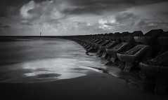 Perch Rock Breakwater (Alan E Taylor) Tags: atmospheric bw bw10stopfilter beach blackwhite blackandwhite cloud coast coastal dark dramatic england europe fineart le lightroom longexposure macphun macphuntonalityck mono monochrome newbrighton noiretblanc ocean sand sea shore sky skylum tourism tourist travel uk unitedkingdom water weather britain british coastline wallasey gb