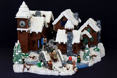 The Streets of Daydelon (soccersnyderi) Tags: lego moc creation model medieval mitgardia mitgardian winter village life town castle bridge stone stonework technique wood wooden house clock tower roof snow snowy icy ice river water bush pine tree chimney door interior pull out rooms irregular border base store shop bakery building build