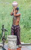 Becoming unsticky and clean (Pejasar) Tags: family business sugarcane processing neardelhi india bath shower clean unsticky teapot pour water faucet bucket sandals outdoors drops refreshed cool boy child young work labor