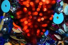 Sequins (Dreaming of the Sea) Tags: macromondays macro christmaslights christmas depthoffield sequins butterfly red blue nikon d5500 tamronsp90mmf2811macro memberschoice bokeh