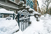 Gateway (Joyce and Steve) Tags: newyorkcity manhattan upperwestside snow snowstorm snowfall gate white blue orange cold winter freshsnow brownstones rowhouses
