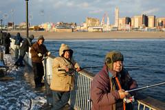 Herring (dtanist) Tags: nyc newyork newyorkcity new york city sony a7 contax zeiss carlzeiss carl planar 45mm brooklyn coney island boardwalk steeplechase pier fishing fisherman fishermen sea herring