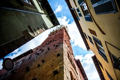 Tower House in Lucca Italy (Daveyal_photostream) Tags: towerhouse lucca italy nikon nikor house buildings sky meandmygear mygearandme mycamerabag windows lookup up d600 clouds bluesky brick architecture historic oldbuilding perspective travel vacation