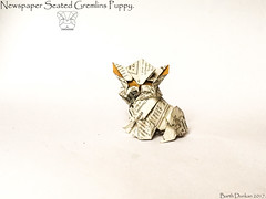Newspaper Seated Gremlins Puppy - Barth Dunkan. (Magic Fingaz) Tags: anjing barthdunkan chien chó dog gremlins hond hund köpek monster origami perro pies пас пес собака หมา 개 犬 狗