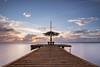 Sunblock needed! (karindebruin) Tags: caribbeansea caribbean caribischgebied bonaire sunset zonsondergang wolken clouds water pier umbrella parasol longexposure langesluitertijden leefilters littlestopper nd06
