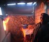Eye On The Tandoor (peterkelly) Tags: tajikistan sarytag fire flame lit hot tandoor oven woman orange bowl bucket