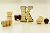 K (adelina_tr) Tags: letter macro doubleexposure whitebackground macromondays stilllife beads text