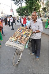 "India Travel Photography ""Knive Seller near Victoria Station Bombay"" Mumbai.049 by Hans Hendriksen (Travel Photography - Reisfotografie) Tags: south india bombay mumbai maharashtra индии мумбаи travel reisfotografie reis reisfoto religion religie temple tempel hindoe hindu jain culture civilisation chhatrapati shivaji terminus victoria train station victorian building colonial british empire architecture dabbawalas dhobi ghat shanti nagar lower parel shantinath ghar derasar central sea cadet corps gateway international airport crawford market gujarat express netaji subhash chandra bose road churchgate boy petrol"