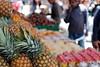 pineapples (overthemoon) Tags: switzerland suisse schweiz svizzera romandie vaud lausanne market fruit exotic people choosing 50mm stall blurry colourful summer archives marché