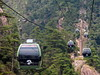 Cable cars going up and down Huangshan / Yellow mountain - China (Germán Vogel) Tags: asia eastasia china travel traveldestinations traveltourism tourism touristattraction landmark holidaydestination famousplace anhuiprovince huangshan yellowmountain mountain mountainrange naturallandscape naturalpark beautyinnature unescoworldheritagesite worldheritage historicalsite green cablecar telecabin transportation mountainside cliff forest