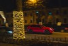 Cayenne (Burak Kebapci) Tags: tree car road street lights pan panning redcar red color drive night city citynight urban life urbanlife decorations decoration trees bokehful moment porsche cayenne fast driving riding ride architecture building