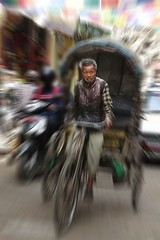 Trolling for fares (posterboy2007) Tags: kathmandu nepal bicycle cyclerickshaw rickshaw street blur people nepali sony