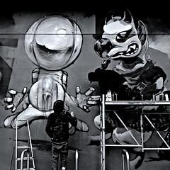 Artists at Work (Akbar Simonse) Tags: denhaag thehague lahaye sgravenhage agga haag holland netherlands nederland straatfotografie streetphotography streetart urbanart graffiti people artist spraycan spuitbus zwartwit bw blancoynegro bn monochrome vierkant square akbarsimonse