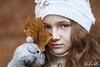 Leaf (Elis's ☾) Tags: leaf portrait freckless efelidi redhead ginger girl child light elisascascitelli canon5dmark3 85mm portfolio fineart face viso art arte artistic conceptual concettuale autumn fall autunno magic magia lentiggini redhair capellirossi nature natura boken 18f model eyes foglia fairy faerie fairytale favola fiaba fable fantastic fantastique fantasia portraiture