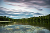 Painted Pond (Matt Molloy) Tags: mattmolloy timelapse photography timestack photostack movement motion painterly clouds trails lines sky pond water reflection lilypads trees birds burnthills ontario canada landscape nature countryside lovelife