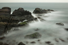 A Study of Three Minutes Exposure (miltonsun) Tags: longexposure dusk seascape bay ngc wave ocean shore seaside coast landscape outdoor clouds sky water rock mountain rollinghills sea sand beach cliff nature nanyarockformations 南雅奇岩 newtaipeicity taiwan smoothwaves rushedwaves